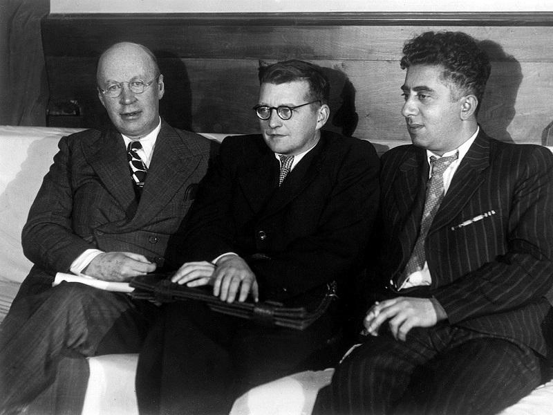 This is a photograph of three giants of 20th century Russian music captured together. From the left: Sergei Prokofiev, Dmitri Shostakovich and Aram Khachaturian.
