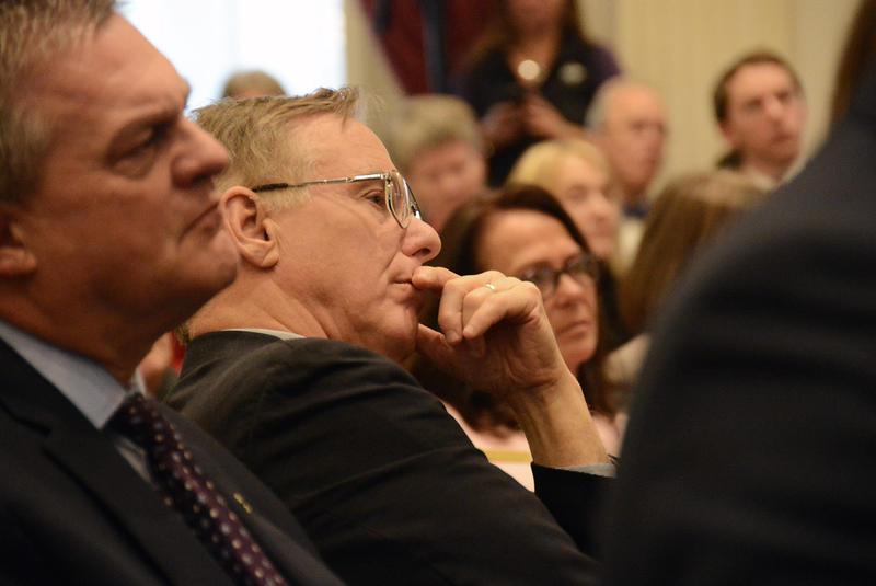 Former Gov. Howard Dean listens to Gov. Scott's remarks.