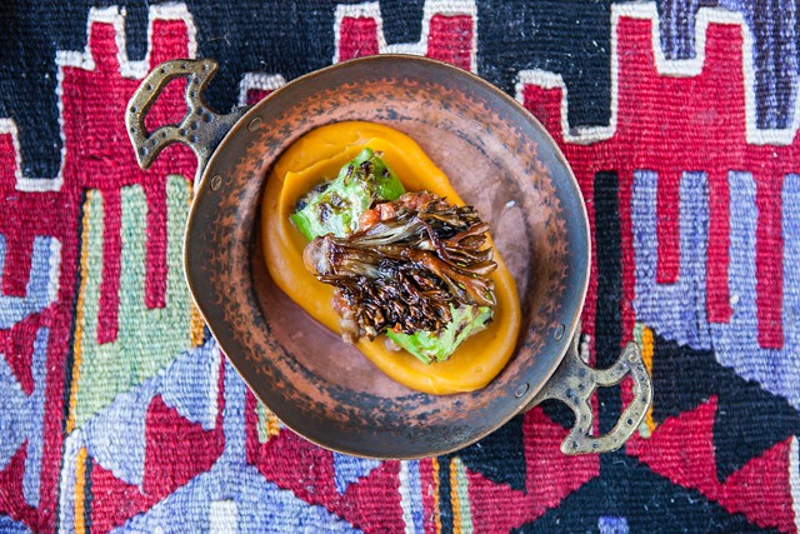 A dish created by Cara Chigazola Tobin; lamb and cabbage sarma with sweet potato puree and crispy hen-of-the-woods mushrooms.