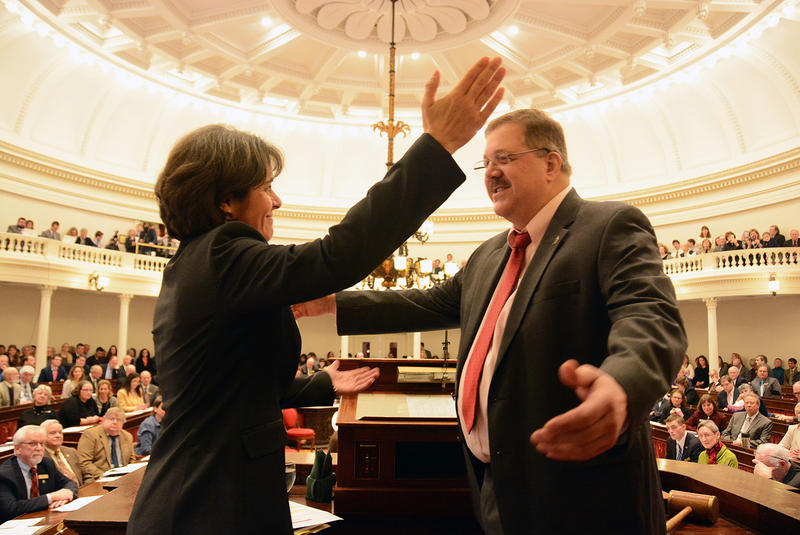 Speaker of the House Mitzi Johnson goes in for a hug with Secretary of State Jim Condos after taking her oath at the Statehouse in Montpelier on Wednesday, the opening day of the 2017 legislative session.