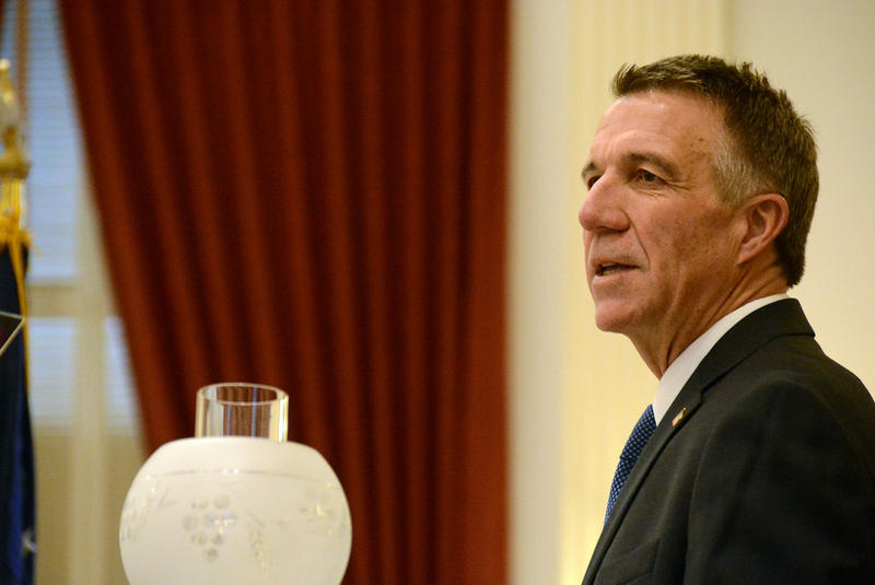 Gov. Phil Scott, shown here at his inauguration on Jan. 5, signed three executive orders on Sunday that could lead to the merging of several government agencies.