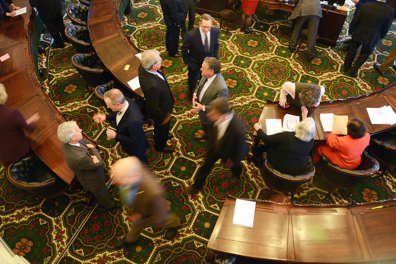 Bustle in the Senate chamber.