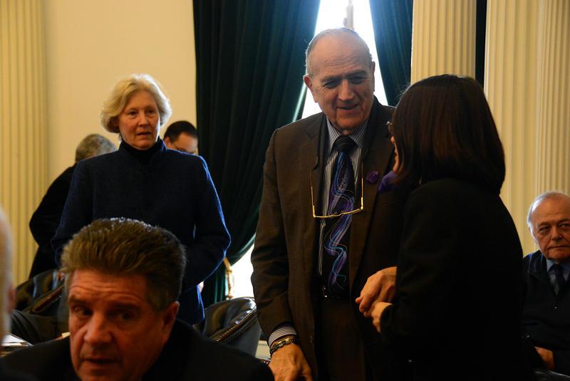Senators, including Grand Isle Sen. Dick Mazza, center, and Calendonia Sen. Jane Kitchel, left, during a recess in the Senate chamber.