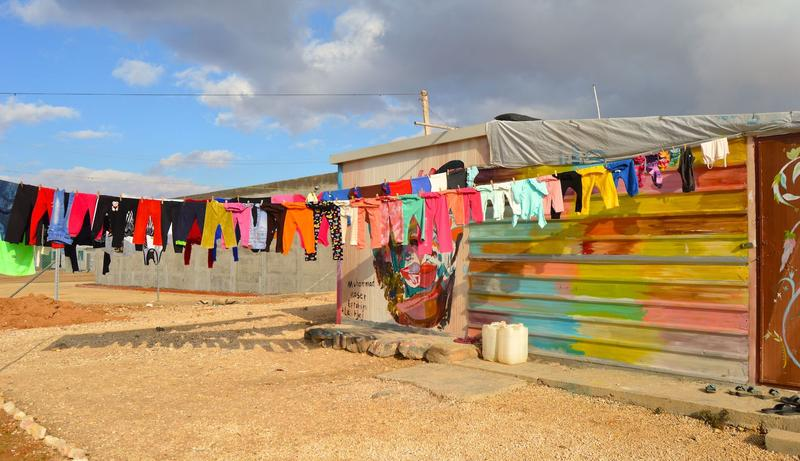 Laundry on a clothes line dries in the wind at the Zaatari refugee camp.