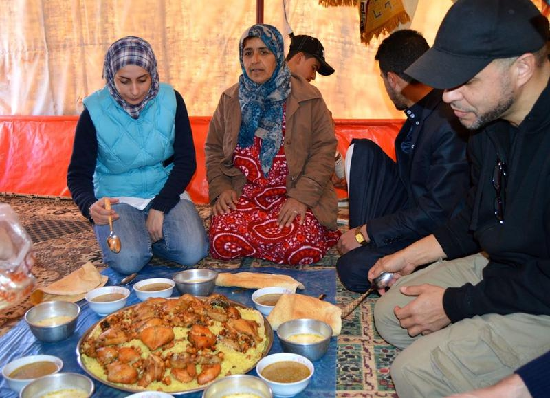 Mariam Mohammed, center, in front of the lunch the family prepared.