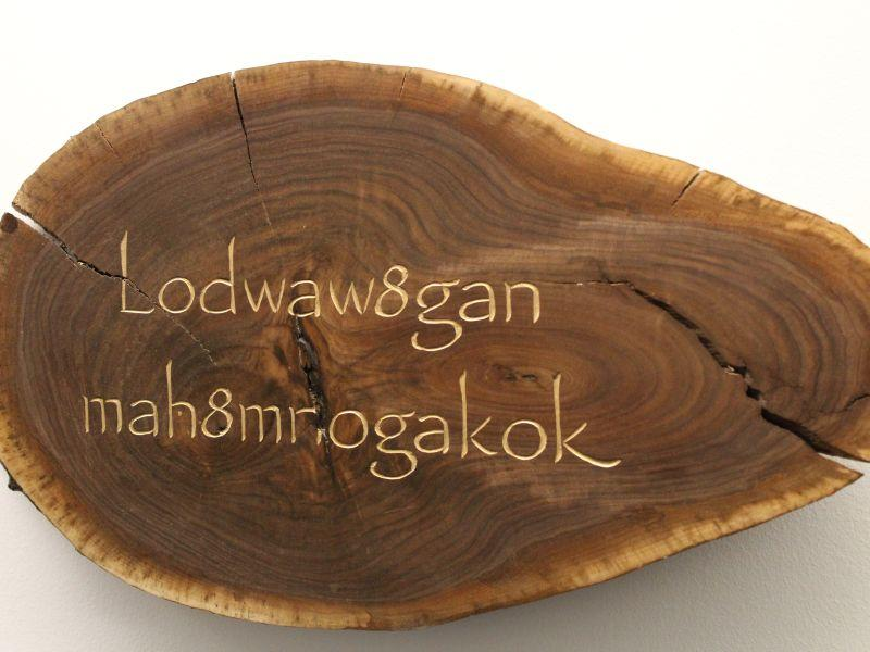 For his exhibition, Tim Brookes carved phrases into indigenous wood using disappearing or endangered alphabets from across the globe. Pictured, in Abenaki, the phrase, 'Language of the grandfathers who went before' is carved into a plank of walnut.