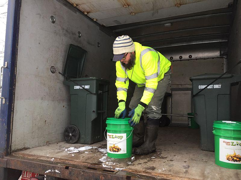 Aaron Shepard of the Northwest Vermont Solid Waste District empties food scrap buckets on the district's new residential collection route. Soon all trash haulers will have to offer food scrap collection to their customers.