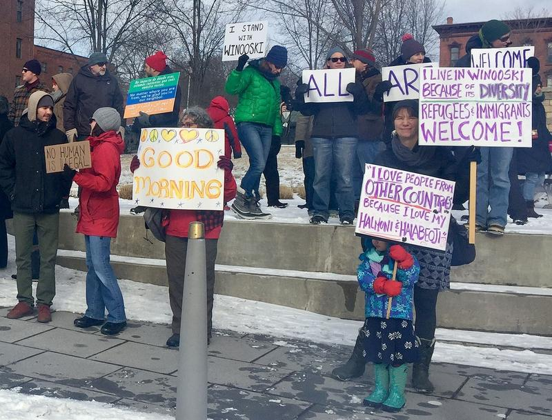 "Winooski residents rally against President Donald Trump's immigration policies on February 4, 2017. Signs include, ""No Human Is Illegal,"" and ""All Are Welcome."""