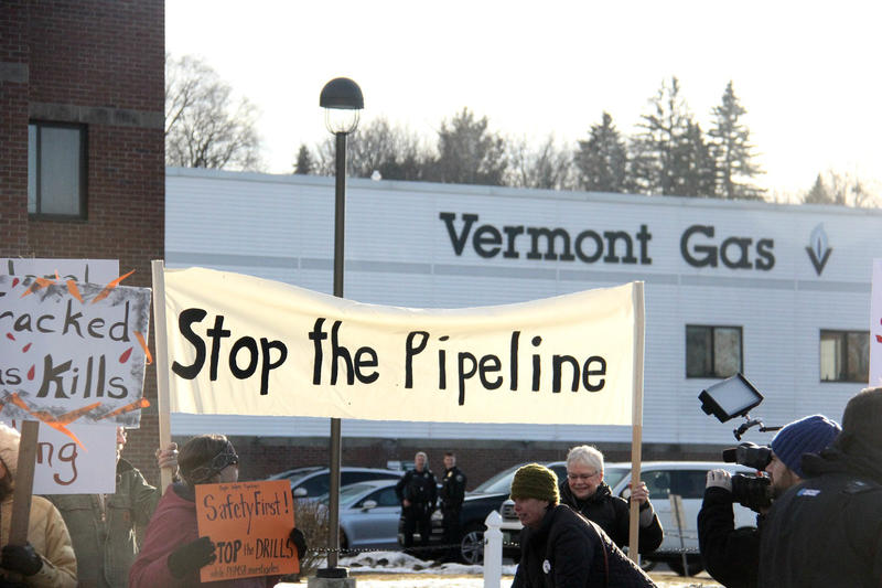 Protestors outside Vermont Gas Systems offices in South Burlington called on the company to halt construction on its pipeline to Addison County.