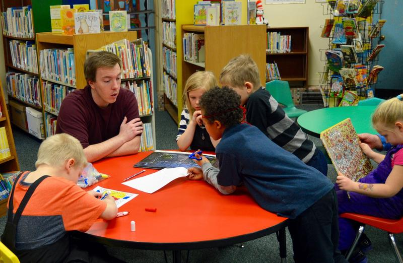 Para-educator Ryan Connell works after school with a group of first and second graders, part of Rutland City's Tapestry after-school program. The program would have to cut staff and services if President Trump's budget proposal is approved.
