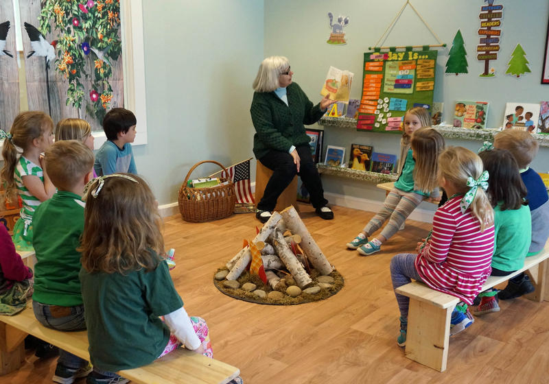 Preschoolers in Hunger Mountain Children's Center's 'Forest Critters' 4-year-old class gather for a story around the campfire. The program's reloation was one of the town's last remaining Irene recovery projects.