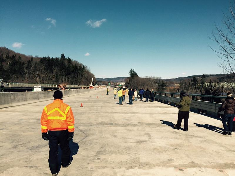 The town of Brattleboro rented buses to allow peoople to walk across the nearly completed Interstate 91 bridge over the West River.