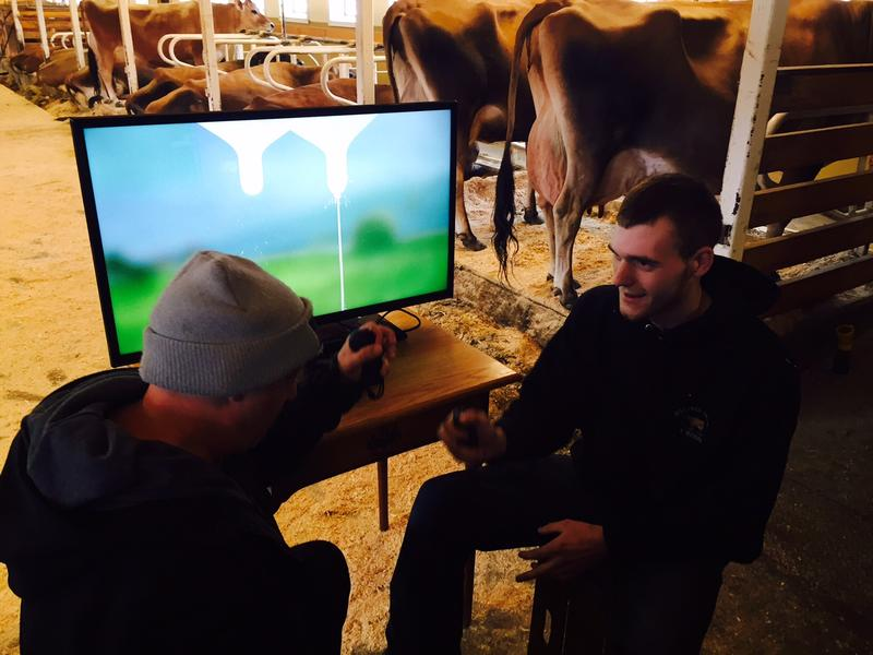 "Tyler Catterall, right, from Billings Farm and Museum in Woodstock, tries his hand at the Nintendo ""Milk"" game. Catterall lost to a gamer from Nintendo."