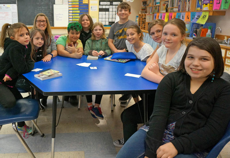 Waterville Elementary School students sit around a table.