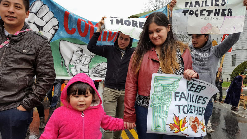 Alex Carrillo, left, with his daughter and wife, leading a 2016 Migrant Justice march. Carrillo, who set to have a DUI charge dismissed on Thursday at the Chittenden County Courthouse, was instead arrested by immigration officials.
