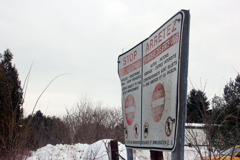 This sign marks the Canadian side of the border at one rural area where many people are crossing illegally into Canada. Mamadou was in the woods somewhere within 20 miles of here.