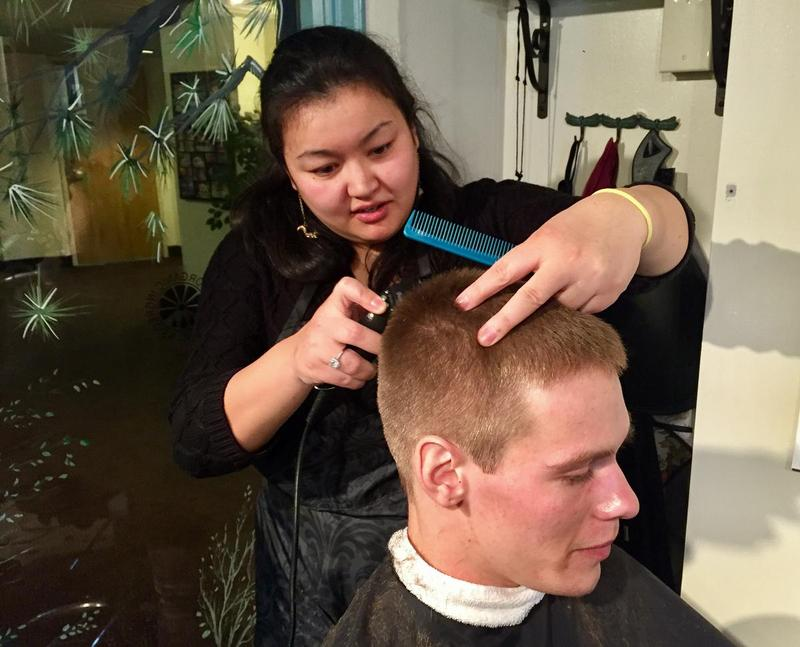 Ashley Bennett, the owner of Fascination Woodland Spa in Lebanon, N.H., gives Troy Schwartz, 23, a half-price haircut as part of her incentive program for people in recovery.