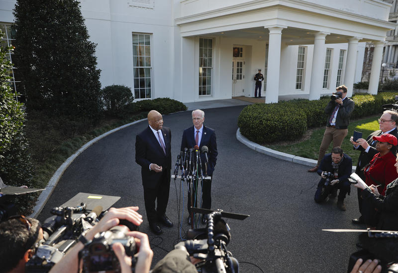 Rep. Peter Welch, right, and Democratic Maryland Rep. Elijah Cummings meet with reporters outside the West Wing of the White House in Washington on Wednesday, March 8, following their meeting with President Donald Trump.