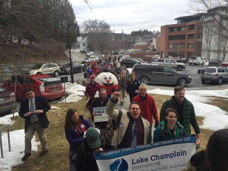 Water quality activists marched to the Statehouse Wednesday to urge lawmakers to fund a $1 billion pollution reduction initiative.