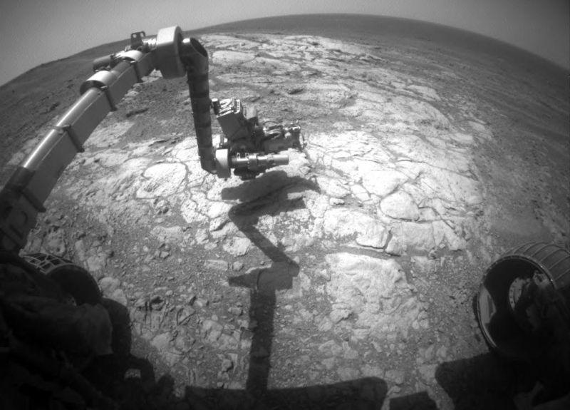 "NASA's Mars Exploration Rover, Opportunity, has extended its robotic arm for studying a light-toned rock target called ""Athens."""