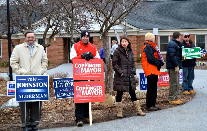 Rutland mayoral candidate Michael Coppinger stands outside a polling place.