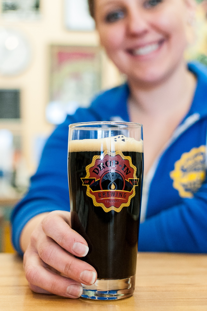 Head brewer, Vilija Bizinkauskas, serves a cold one at Middlebury's Drop-In Brewing.