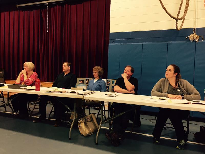 The Wilmington School Board listens to voters criticize the state's education funding formula at Town Meeting last week.