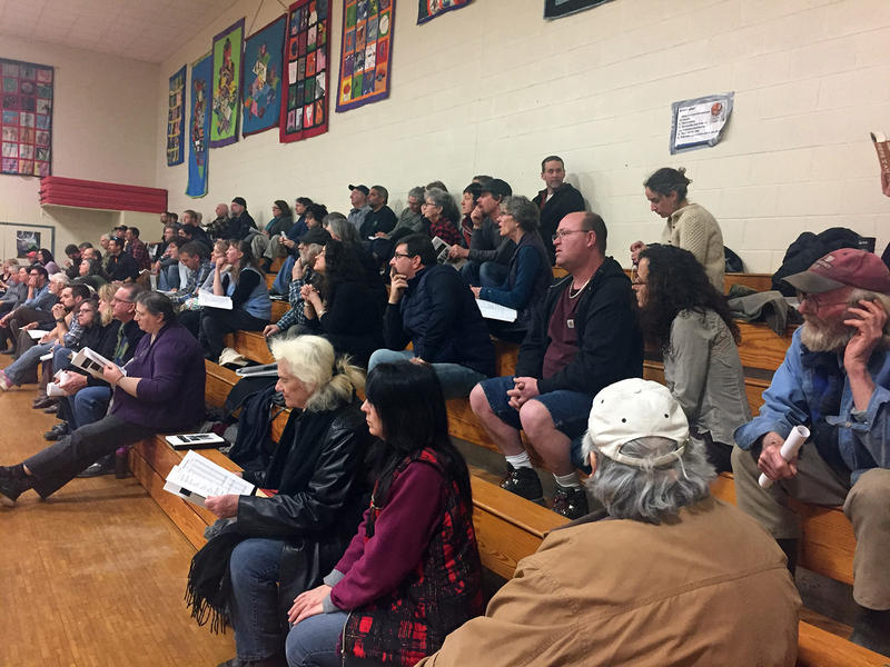 About 60 people gathered on bleachers at Wolcott's town meeting in 2017.