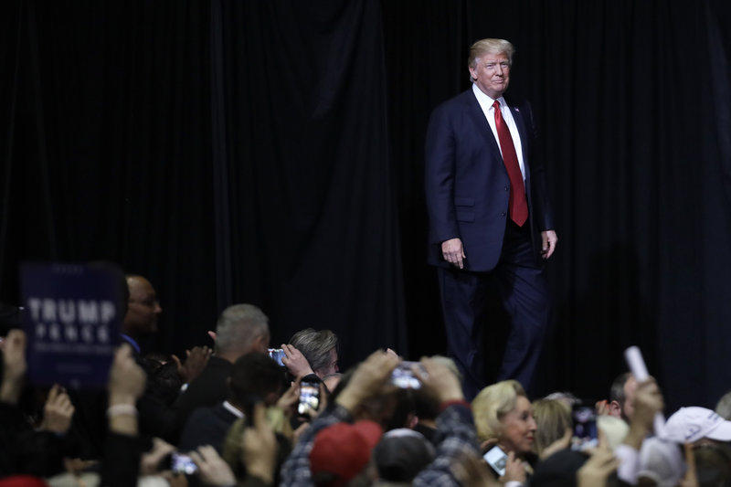 President Donald Trump walks onto the stage at a rally in Nashville, Tenn. Saturday, April 29 marks 100 days since Trump was sworn in as president.