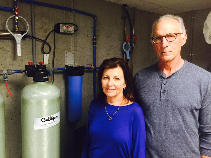 Laurie and John Camelio now have a carbon water filter in the basement of their Bennington home. The state wants to extend municipal waterlines as a long-term solution for the community's PFOA contamination, but progress has stalled.