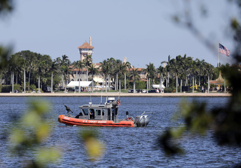The U.S. Coast Guard patrols in front of President Donald Trump's Mar-a-Lago resort on April 7. Dartmouth Professor Brendan Nyhan says Trump's frequent trips to the estate are among one of the unusal activities of the new president.