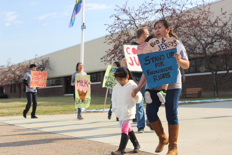 Dairy worker Yessica Sanchez and her children were among protestors outside the Ben & Jerry's offices on Tuesday. Sanchez says the unsanitary conditions at the farm have made her children sick.
