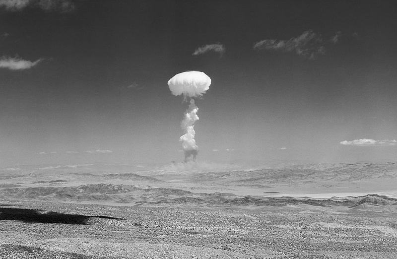 A gigantic pillar of smoke with the familiar mushroom top climbs above Yucca Flat during nuclear detonation in Las Vegas, Nev., April 22, 1952.