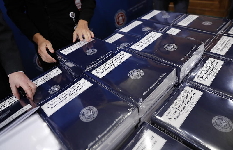 Senate Budget committee staff members lay out copies of President Donald Trump's fiscal year 2018 budget on Tuesday. Senators Patrick Leahy and Bernie Sanders both have strong words about the president's spending proposals.