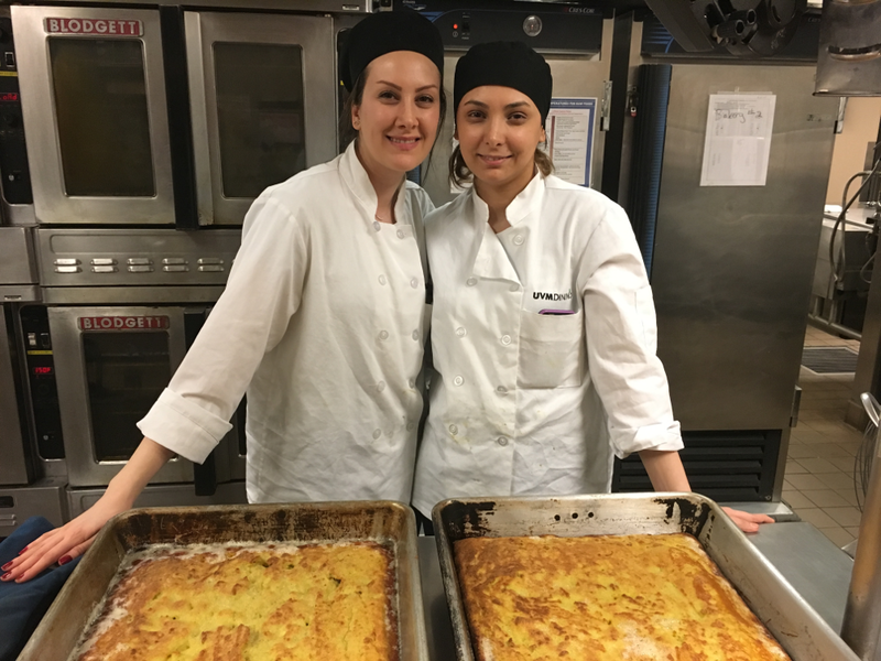 UVM Iranian Student Association members Agrin Davari and Shiva Kiani prepare a traditional baked potato dish for a dinner and cultural event.