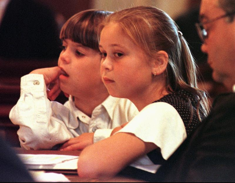 Eleven year old Katherine Stevens, right, and nine year old Austin Anderson, listen to arguments in Vermont Superior Court, in Hyde Park, Oct. 22, 1997. The two children were part of a lawsuit challenging Act 60, by schoolchildren in Stowe.