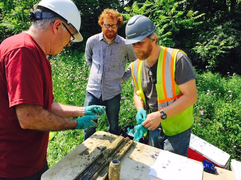 DEC hazardous waste manager John Schmeltzer, left, David Bond from Bennington College, and environmental consultant Steve Shaw look at a soil sample at Bennington College.