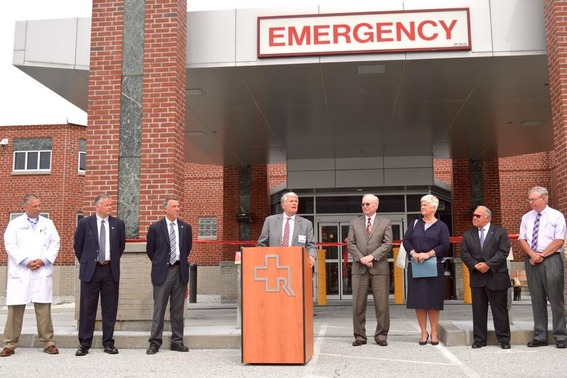 Rutland Regional Medical Center CEO Tom Huebner speaks at the podium in June at a celebration of the completion of the hospital's emergency department expansion. Huebner recently announced he will retire in March 2018.