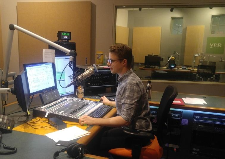 Henry Epp prepares for the broadcast of All Things Considered in VPR's talk studio.