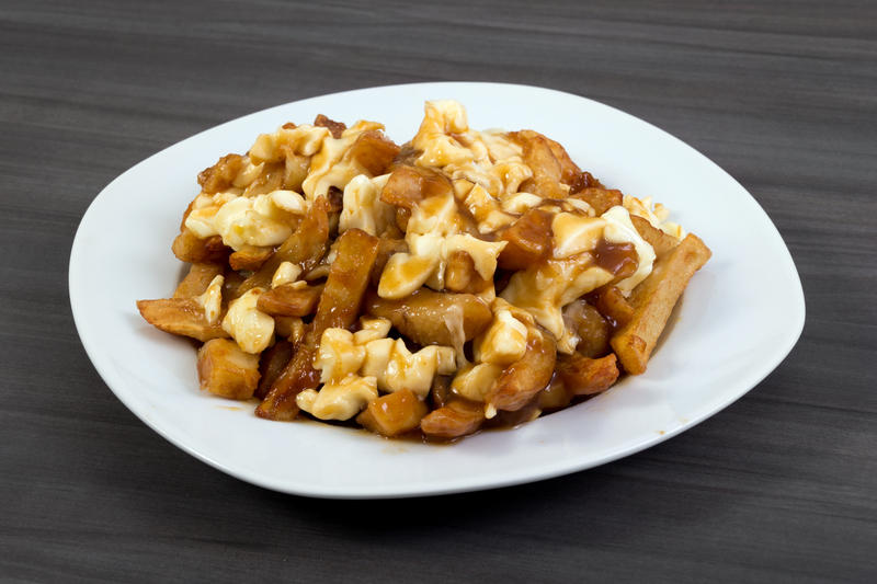 Poutine is a dish of French fries, cheese curds and gravy.  The dish's modern perception as a Canadian dish, rather than Quebecois dish, is the subject of a recently published paper by UVM graduate student Nicolas Fabien-Ouellet.