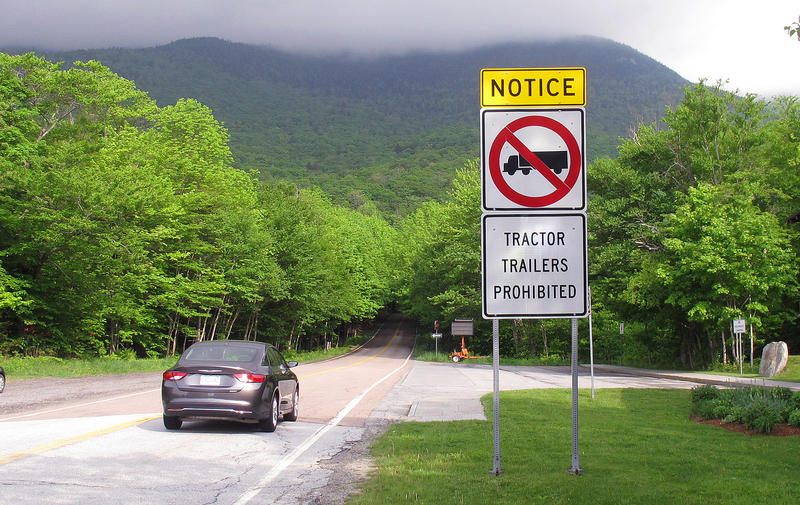 A sign in Stowe alerts trucks on Route 108 before the Smugglers' Notch section, as seen in this June 3, 2016 photo. Josh Schultz of the Vermont Agency of Transportation is tasked with trying to fix the problem of stuck trucks in Smugglers' Notch.