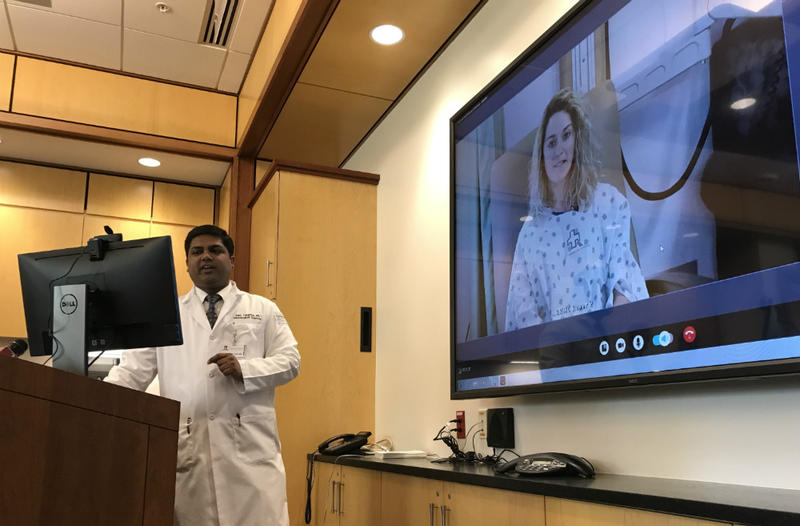 Dr. Ajay Tunguturi, a neurologist at the University of Vermont Medical Center, demonstrates telemedicine with a mock patient connected securely from Rutland Regional Medical Center.
