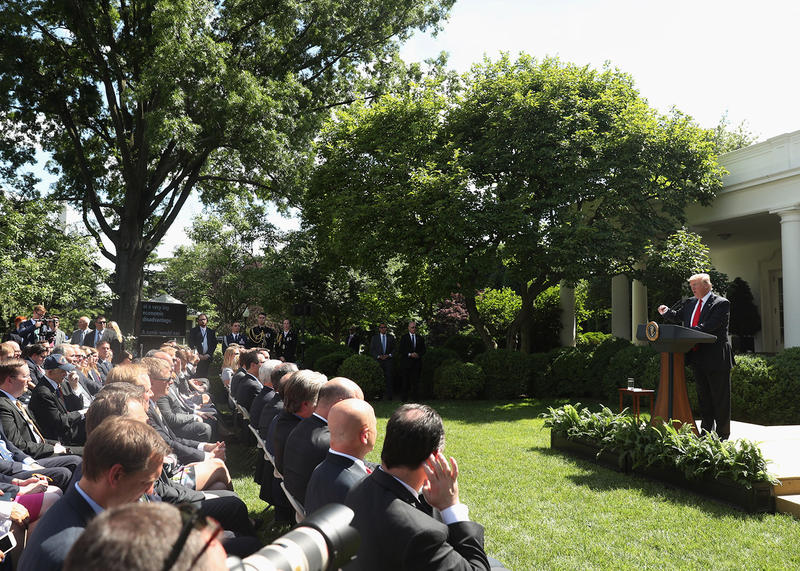 President Donald Trump announces the United States' withdrawal from the Paris climate change accord on Thursday at the Rose Garden of the White House in Washington.