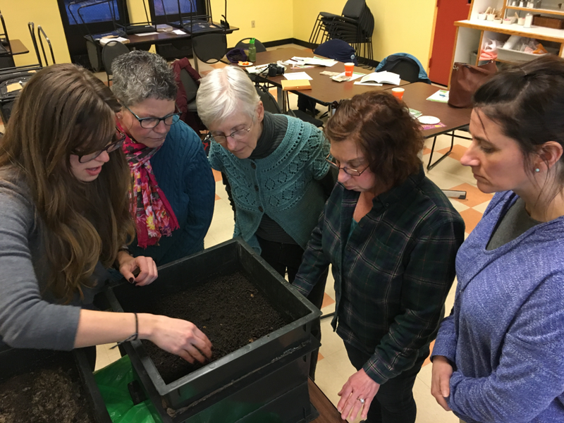 Jaclyn Hochreiter, public outreach coordinator for Addison County Solid Waste Management District, shows a worm composting bin to workshop participants.