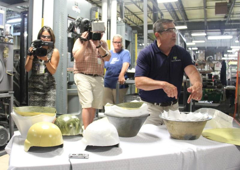 Eric Hounchell, vice president of armor and global operations for Revision Military, demonstrated how layers of material are formed into bulletproof helmets at Revision Military's facility in Newport.