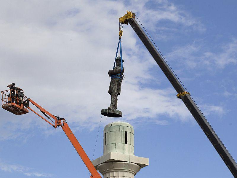 A statue of Confederate General Robert E. Lee is removed from Lee Circle in New Orleans in May, the last of four monuments to Confederate-era figures to be removed.