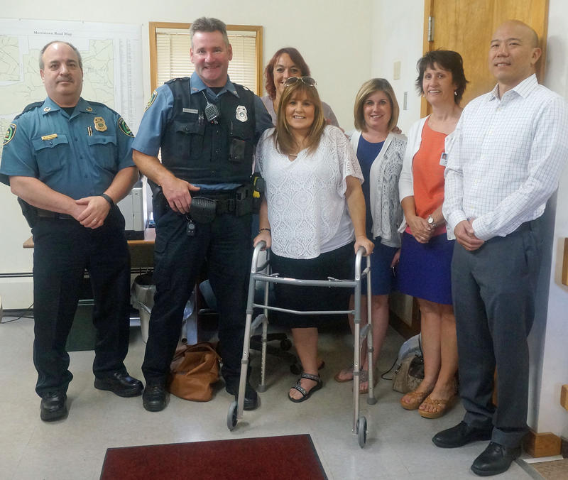 Gathered for the award ceremony are (l to r) Morristown Police Chief Richard Keith, Officer Lance D. Lamb, Cheryl Machia, Wendy Domina, Darlene Reynolds, UVM Medical Center Trauma Program Manager Jennifer Gratton and Trauma/Acute Care Surgeon Tim H. Lee.