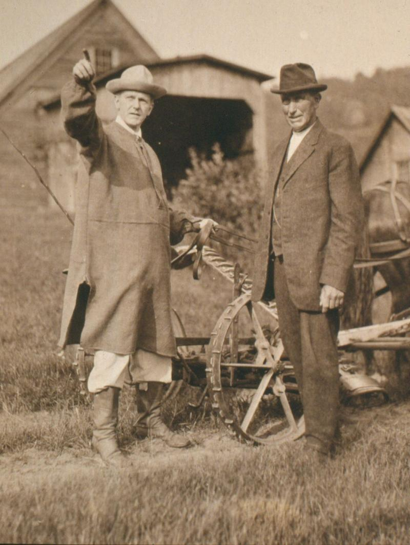 Calvin Coolidge, 30th President of the United States and native Vermonter, was fond of wearing the frock his grandfather had worn to do farm chores; the other individual is Calvin's father, Col. John Coolidge.