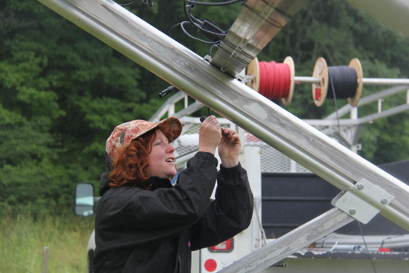 Catamount Solar is installing an 8.7 kilowatt system in a homeowner's yard in East Montpelier. Kestrel Marcel of Catamount Solar is connecting the optimizers, which are a converter technology that helps maximize the energy harvested from the panels.