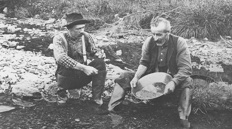 Men panning for gold in an 1887 photograph from the Plymouth Historical Society.